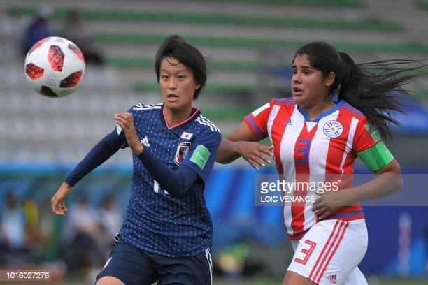 Japan's forward Saori Takarada vies with Paraguay's defender Lorena Alonso during the Women's World Cup U20 Group C football match between Japan and...