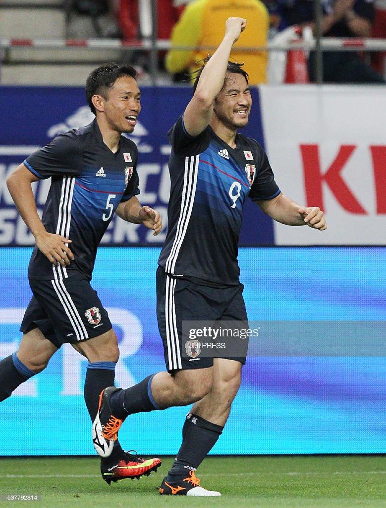 Japan's forward Shinji Okazaki (R) celebrates his goal against Bulgaria during their football match at the Kirin Cup in Toyota city, Aichi prefecture on June 3, 2016. / AFP / JIJI PRESS / JIJI PRESS / Japan OUT