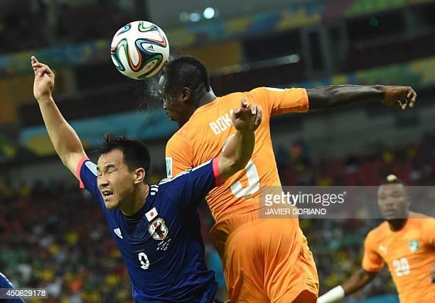 Japan's forward Shinji Okazaki vies with Ivory Coast's defender Arthur Boka during a Group C football match between Ivory Coast and Japan at the...