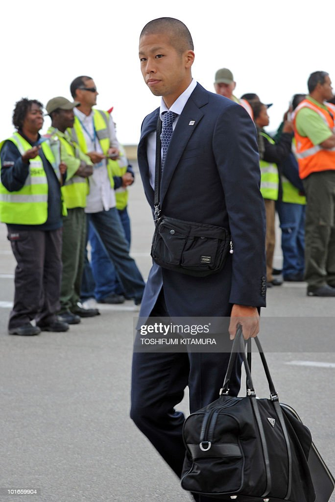 Japan's forward Takayuki Morimoto walks toward the terminal upon the team's arrival at George airport on June 6, 2010. Japan's national football team arrived here to hold their 2010 World Cup training camp ahead of the start of the tournament on June 11.