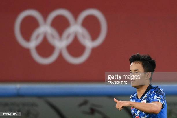 Japan's forward Takefusa Kubo celebrates after scoring the opening goal during the Tokyo 2020 Olympic Games men's group A first round football match...
