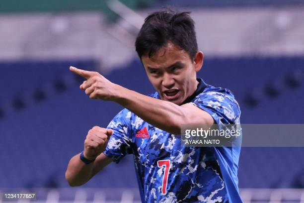 Japan's forward Takefusa Kubo celebrates his opening goal during the Tokyo 2020 Olympic Games men's group A first round football match between Japan...