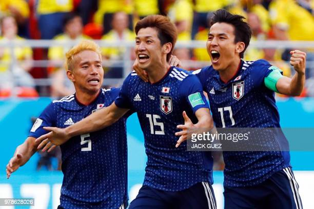 TOPSHOT Japan's forward Yuya Osako celebrates with Japan's defender Yuto Nagatomo and Japan's midfielder Makoto Hasebe after scoring a goal during...