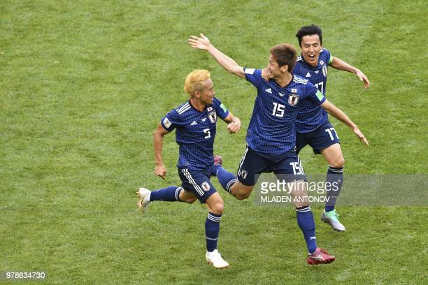 TOPSHOT Japan's forward Yuya Osako celebrates with Japan's defender Yuto Nagatomo and Japan's midfielder Makoto Hasebe after scoring their second...