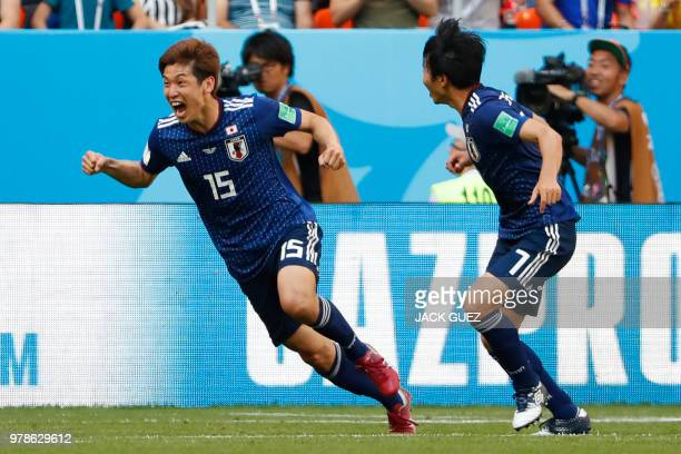 Japan's forward Yuya Osako celebrates with Japan's midfielder Gaku Shibasaki after scoring a goal during the Russia 2018 World Cup Group H football...