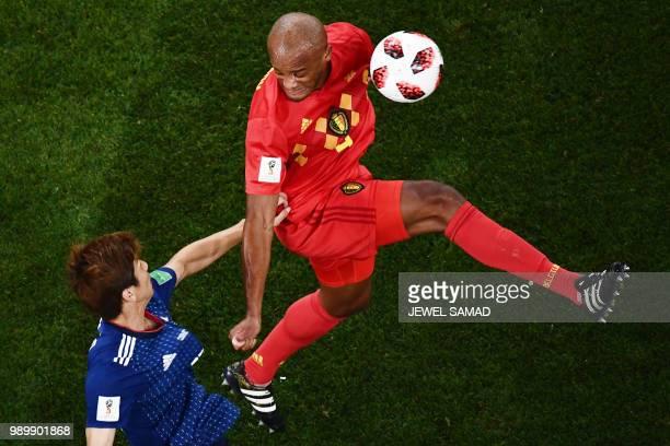 Japan's forward Yuya Osako challenges Belgium's defender Vincent Kompany during the Russia 2018 World Cup round of 16 football match between Belgium...