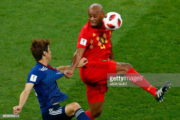 TOPSHOT Japan's forward Yuya Osako heads the ball with Belgium's defender Vincent Kompany during the Russia 2018 World Cup round of 16 football match...