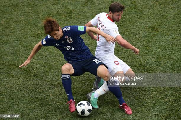Japan's forward Yuya Osako is tackled by Poland's defender Bartosz Bereszynski during the Russia 2018 World Cup Group H football match between Japan...