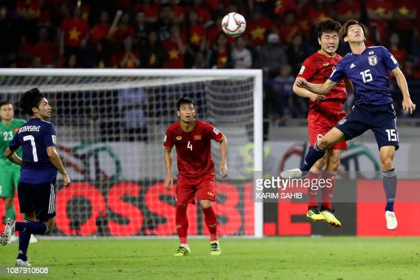Japan's forward Yuya Osako vies for the header with Vietnam's midfielder Xuan Truong Luong during the 2019 AFC Asian Cup quarterfinal football match...