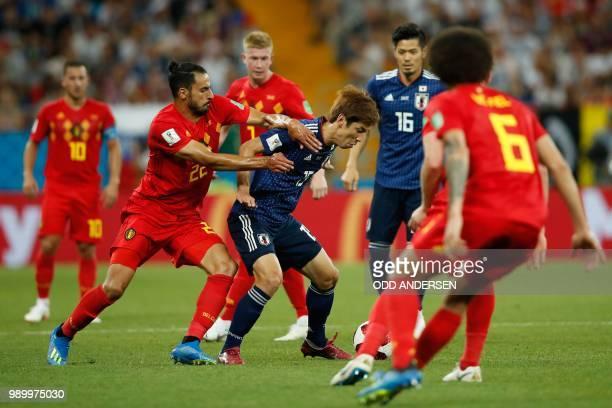 Japan's forward Yuya Osako vies with Belgium's midfielder Nacer Chadli during the Russia 2018 World Cup round of 16 football match between Belgium...