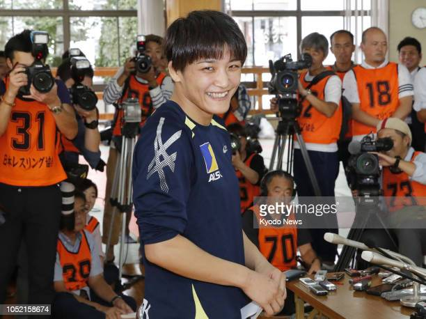 Japan's fourtime Olympic wrestling champion Kaori Icho meets the press after winning the 57kilogram division at the All Japan Women's Open...
