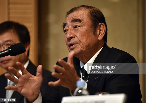 Japan's Fujifilm Holdings chairman and CEO Shigetaka Komori announces the company's threeyear business strategy in Tokyo on November 11 2014 as the...