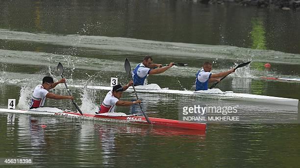 Japan's Fujishima Hiroki and Matsushita Momotaro lead Kazakhstan's Yevgeniy Alexeyev and Alexey Dergunov during the men's kayak double 200m event of...