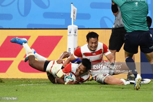 Japan's Full back Kotaro Matsuhima scores a try during the Japan 2019 Rugby World Cup Pool A match between Japan and Samoa at the City of Toyota...