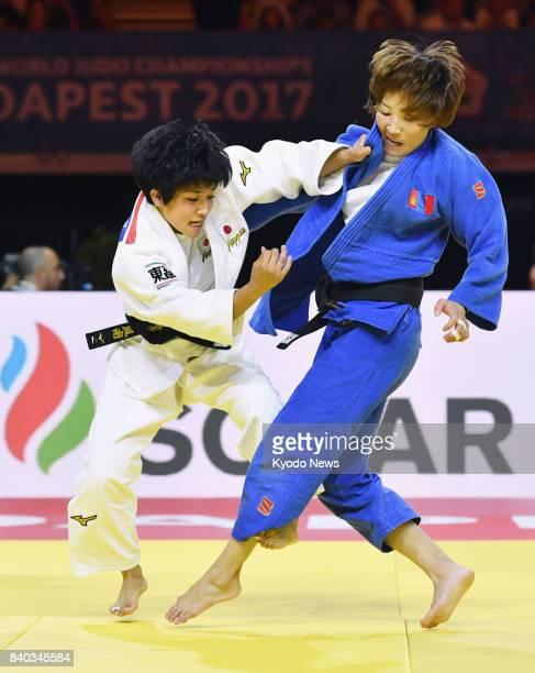 Japan's Funa Tonaki and Urantsetseg Munkhbat of Mongolia compete in the women's 48kilogram final at the world judo championships in Budapest on Aug...