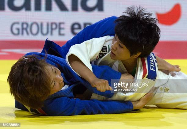 Japan's Funa Tonaki competes to win gold against Mongolia's Urantsetseg Munkhbat during their final in the womens 48kg category at the World Judo...