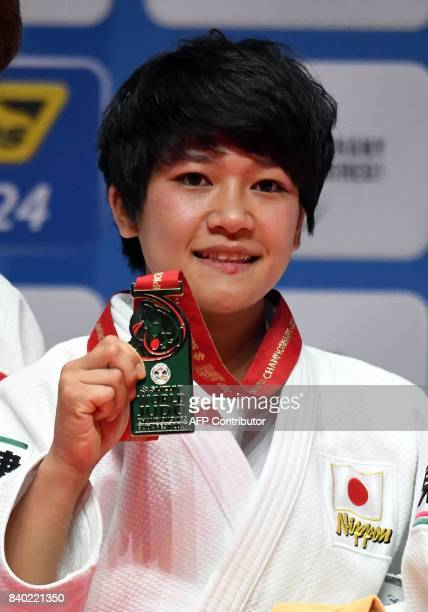 Japan's Funa Tonaki Gold medalist of the womens 48kg category celebrates her gold during thier medal ceremony of the World Judo Championships in...