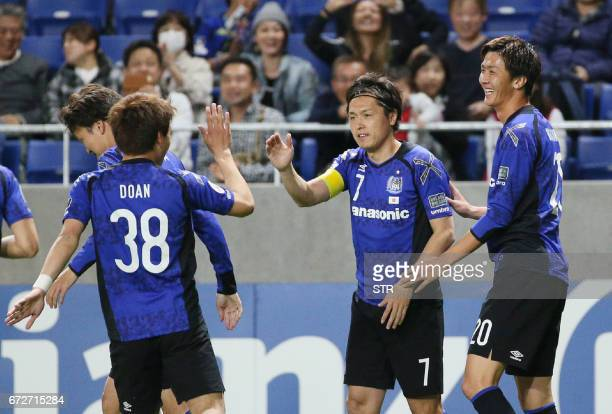 Japan's Gamba Osaka midfielder Ritsu Doan celebrates his goal against Australia's Adelaide United during the AFC Champions League football match at...