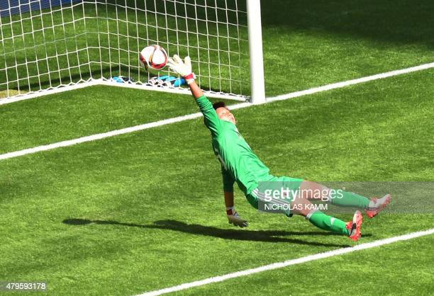 Japan's goalkeeper Ayumi Kaihori fails to stop a goal during the 2015 FIFA Women's World Cup final at BC Place Stadium in Vancouver on July 5 2015...