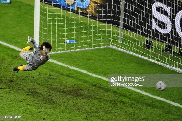 Japan's goalkeeper Ayumi Kaihori jumps for the ball during the FIFA Women's Football World Cup final match Japan vs USA on July 17 2011 in Frankfurt...