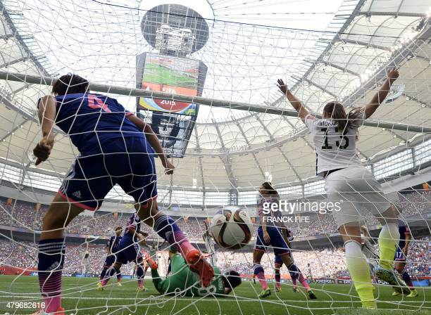 Japan's goalkeeper Ayumi Kaihori lies on the field next to USA forward Alex Morgan and Japan's defender Saki Kumagai after a goal of USA midfielder...
