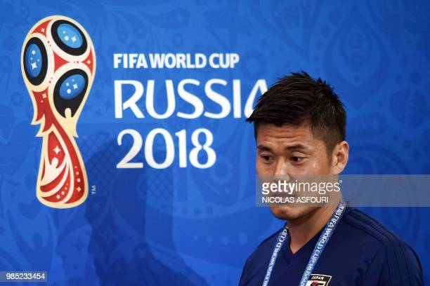 Japan's goalkeeper Eiji Kawashima arrives for a press conference on the eve of the Russia 2018 World Cup Group H football match between Japan and...