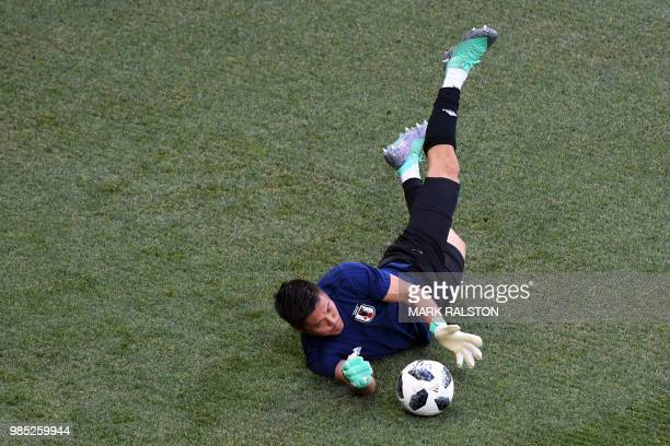 Japan's goalkeeper Eiji Kawashima attends a training session on the eve of the Russia 2018 World Cup Group H football match between Japan and Poland...