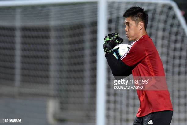 Japan's goalkeeper Eiji Kawashima catches the ball during a practice session at the Independencia stadium in Belo Horizonte state of Minas Gerais...