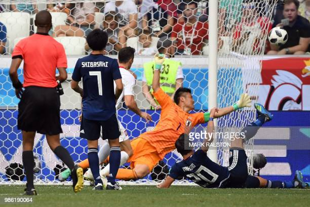 Japan's goalkeeper Eiji Kawashima dives during the Russia 2018 World Cup Group H football match between Japan and Poland at the Volgograd Arena in...