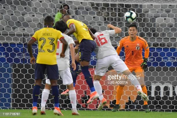 Japan's goalkeeper Eiji Kawashima eyes the ball during the Copa America football tournament group match against Ecuador at the Mineirao Stadium in...