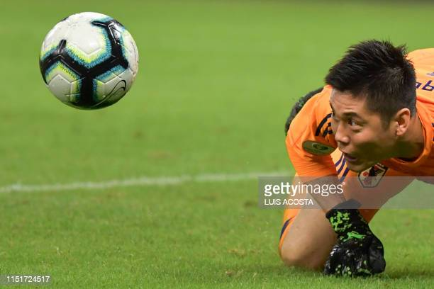 TOPSHOT Japan's goalkeeper Eiji Kawashima eyes the ball during their Copa America football tournament group match at the Mineirao Stadium in Belo...