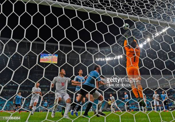 Japan's goalkeeper Eiji Kawashima goes for the ball during the Copa America football tournament Group C match between Uruguay and Japan at the Gremio...