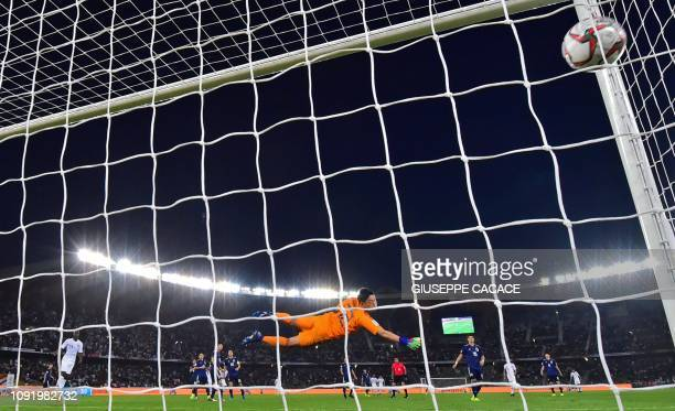 TOPSHOT Japan's goalkeeper Shuichi Gonda concedes a second goal during the 2019 AFC Asian Cup final football match between Japan and Qatar at the...