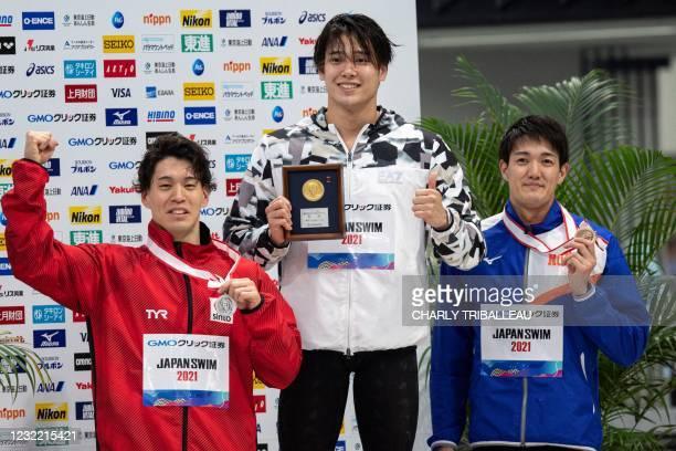 Japan's gold medalist Katsumi Nakamura , silver medalist Namba Akira and bronze medalist Kosuke Matsui pose after competing in the men's 50m...