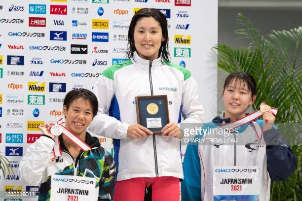 Japan's gold medalist Miki Takahashi , silver medalist Anna Konishi and bronze medalist Miri Sasaki pose after competing in the women's 50m...