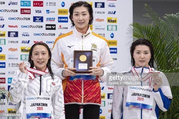 Japan's gold medalist Rikako Ikee , silver medalist Ai Soma and bronze medalist Yukina Hirayama pose after competing in the women's 50m butterfly...