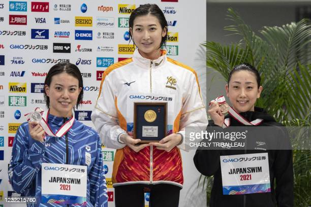 Japan's gold medalist Rikako Ikee , silver medalist Rika Omoto and bronze medalist Chihiro Igarashi pose after competing in the women's 50m freestyle...
