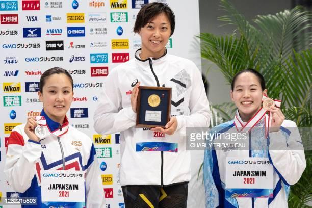 Japan's gold medalist Satomi Suzuki , silver medalist Kanako Watanabe and bronze medalist Chihiro Saito pose after competing in the women's 50m...