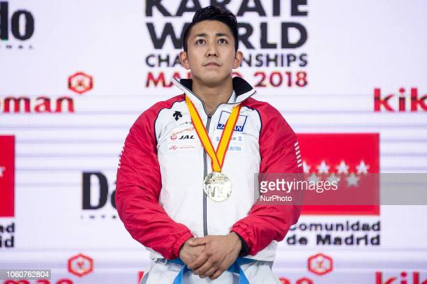 Japan's gold medallist Ryo Kiyuna pose on the podium after the Kata individual male competition during the 24th Karate World Championships at Wizink...
