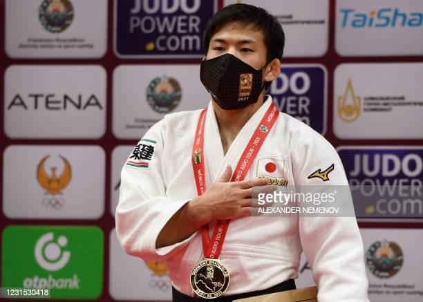 Japan's gold medallist Ryuju Nagayama stands on the podium of the men -60kg category of the Tashkent Grand Slam judo tournament at the Humo Arena in...