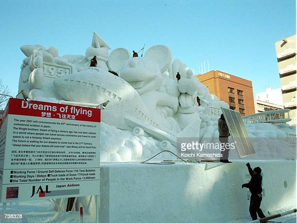 Japan's Ground SelfDefense members create a snow sculpture in preparation for the Snow Festival February 4 2001 in Sapporo northern Japan About 22...