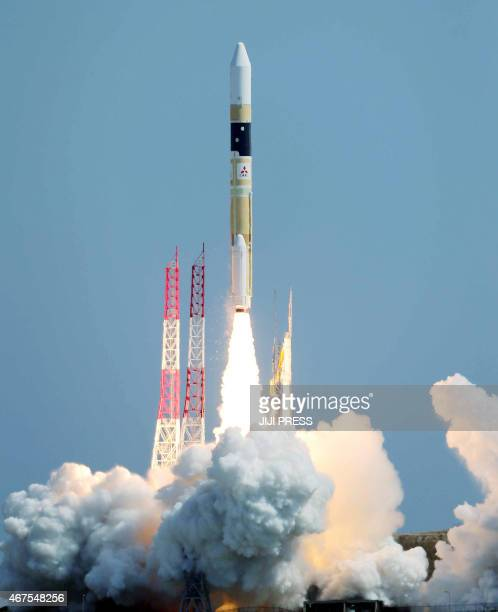 Japan's H2A rocket carrying an informationgathering satellite lifts off from the launching pad at the Tanegashima Space Center in Tanegashima island...