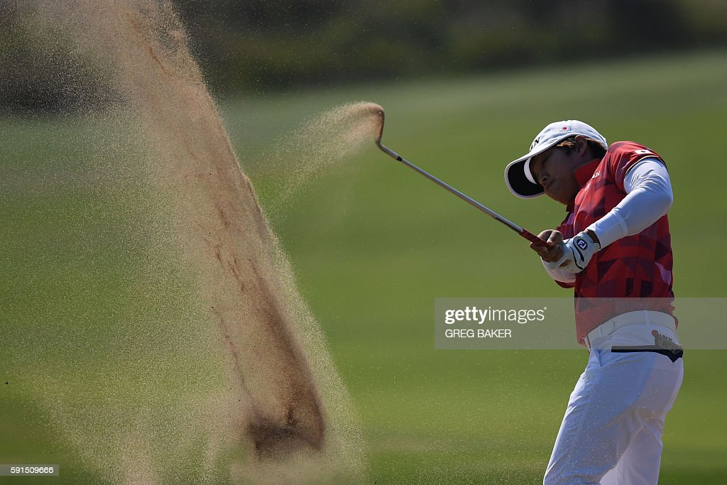 TOPSHOT - Japan's Harukyo Nomura competes in the Women's individual stroke play at the Olympic Golf course during the Rio 2016 Olympic Games in Rio de Janeiro on August 17, 2016. / AFP / Greg BAKER