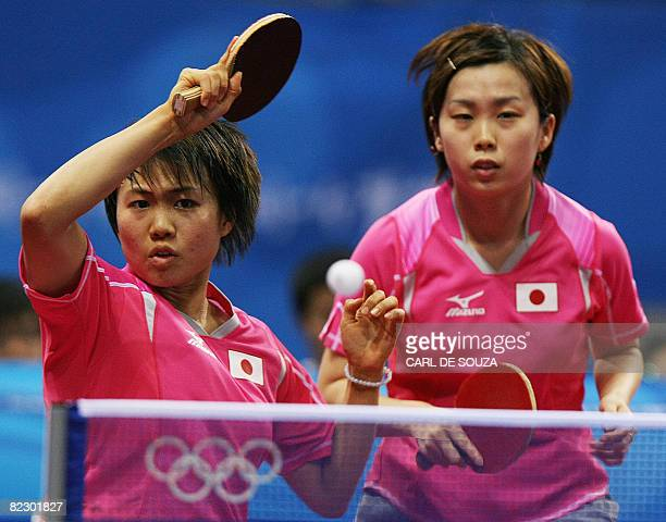 Japan's Haruna Fukuoka and Hirano Sayaka are pictured in action during the women's team table tennis qualification round at the Peking University...