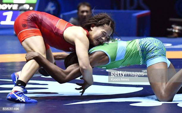 Japan's Haruna Okuno and Nigeria's Odunayo Folasade Adekuoroye compete in the women's 55kilogram final at the world wrestling championships in Paris...