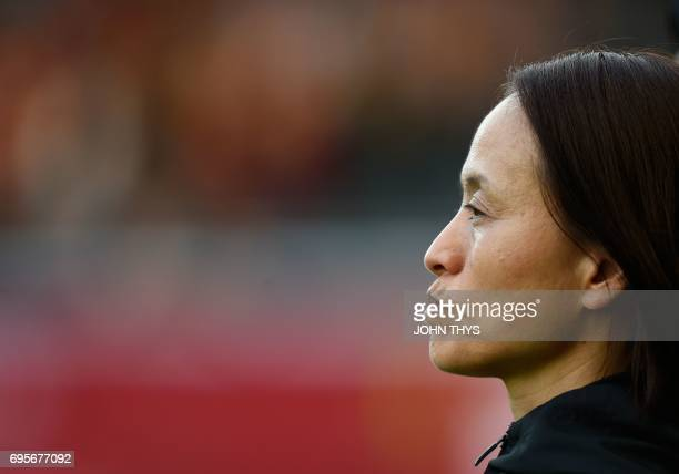 Japan's head coach Asako Takakura looks on during the Women's International friendly football match between Belgium and Japan at the Eneco Stadion on...