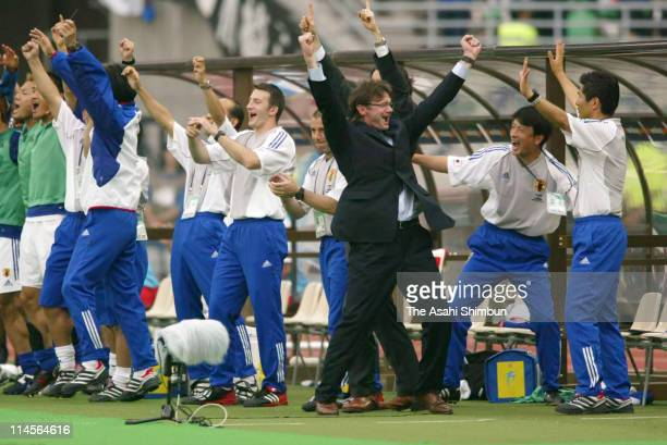 Japan's head coach Philippe Troussier and staffs celebrates the win during the 2002 FIFA World Cup Korea Japan Group H match between Japan and...