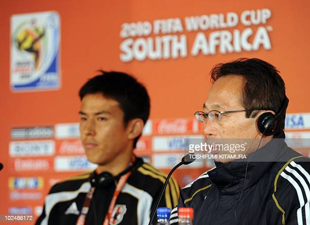 Japan's head coach Takeshi Okada answers a question during a press conference with Makoto Hasebe following their official training session at the...