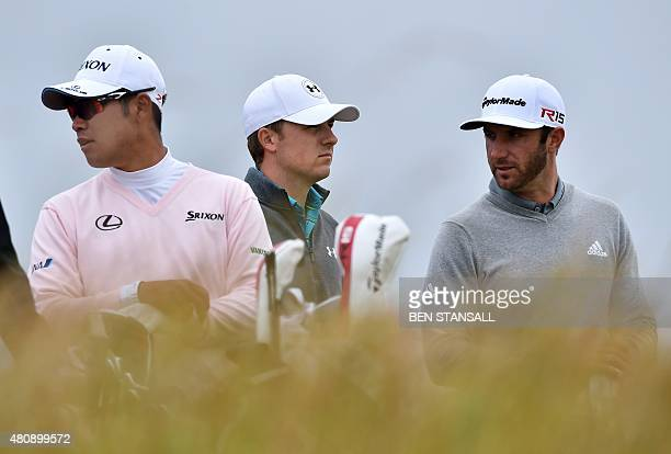 Japan's Hideki Matsuyama US golfer Jordan Spieth and US golfer Dustin Johnson wait on the 6th tee during his first round on the opening day of the...