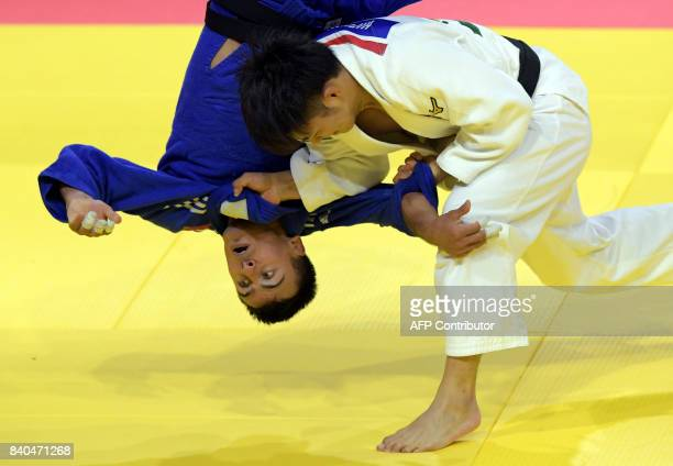 TOPSHOT Japan's Hifumi Abe competes with Ukraine's Georgii Zantaraia during their match in the mens 66kg category at the World Judo Championships in...